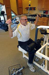 Larry Blend, 71, of Fairview works out at the gym in the clubhouse of his community, Heritage Ranch.