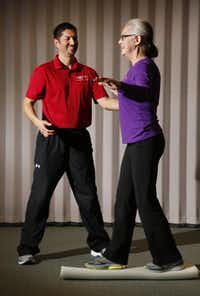 Maness and Pian demonstrate an exercise for core stability standing on a roller.Kye R. Lee