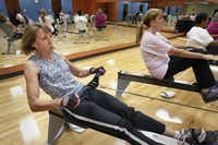 A rowing class provides a low-impact workout that targets every muscle group and burns lots of calories.