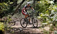 Todd Codish, 51, a triathlete and level II triathlete coach, rides the trails at Murrell Park in Flower Mound, on Lake Grapevine on Tuesday morning, October 8, 2013. Codish underwent extensive back surgery in October of 2011 and was cleared to train without any limits last year.