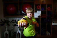 Karen Raley, 60, strengthens her arms with workout bands during her boxing class with instructor Ray Haynes.