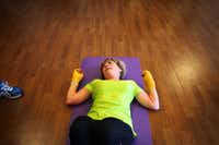 Karen Raley, 60, takes a breather after working on her abs, part of a boxing class with instructor Ray Haynes.