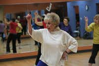 Louise Yoss calls her Silver Sneakers class joyful. Yoss started exercising four years ago at age 74.