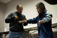 Warrett Kennard, a General and Vascular Surgeon at The Heart Hospital Baylor Plano, shows his daughter Nicole Kennard where to place her hand while giving CPR while attend a free CPR class at The Heart Hospital Baylor Plano in Plano, Texas on Saturday, January 15, 2011. (Ryan C. Henriksen/The Dallas Morning News)