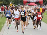 Runners begin the 10k race of the Tour des Fleurs behind the Dallas Arboretum on Saturday, Sep. 15, 2012.