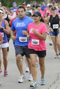 Joe Perez, left, and Maria King begin the the 10k race of the Tour des Fleurs behind the Dallas Arboretum on Saturday, Sep. 15, 2012.