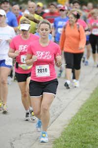Ashley Weaver begins the the 10k race of the Tour des Fleurs behind the Dallas Arboretum on Saturday, Sep. 15, 2012.