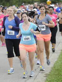 Christi Pipkin, left, Beth Lynch, center, and Teal Perez begin the the 10k race of the Tour des Fleurs behind the Dallas Arboretum on Saturday, Sep. 15, 2012.
