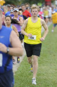 Sepatian Spears begins the the 10k race of the Tour des Fleurs behind the Dallas Arboretum on Saturday, Sep. 15, 2012.