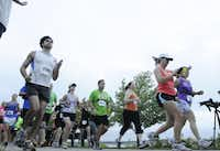 Runners begin the 20k race of the Tour des Fleurs behind the Dallas Arboretum on Saturday, Sep. 15, 2012.