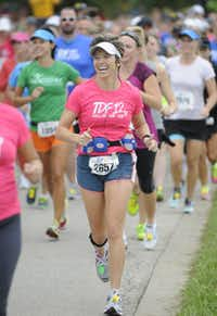 Tracy Huber begins the the 10k race of the Tour des Fleurs behind the Dallas Arboretum on Saturday, Sep. 15, 2012.