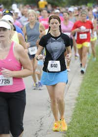Gena Johnson begins the the 10k race of the Tour des Fleurs behind the Dallas Arboretum on Saturday, Sep. 15, 2012.