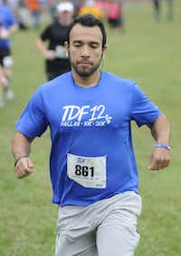 Alonzo Rios begins the the 10k race of the Tour des Fleurs behind the Dallas Arboretum on Saturday, Sep. 15, 2012.