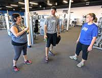 Shelly James (left)  talks with her health coach Josh Rangel (center) of Wylie and fellow class member Courtney Merrett of Sachse after their work out at the 24Xpress gym in Sachse.
