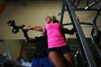 Nicole Petrick, 24, with her personal trainer Tim McComsey, 29, works on her upper body, on Oct. 20, 2011 at Just Fitness in Carrollton, Texas. Ben Torres/Special Contributor