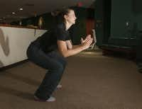 Kim Williams, a trainer at Baylor's Tom Landry Fitness Center demonstrates jump squats.