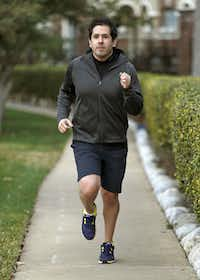 Justin Ozuna, 31, of Plano, runs near his residence on Wednesday morning, February 27, 2013. He has been dealing with leukemia for seven years and participated in his first 5K run this past weekend.