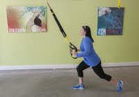 Mallory Mansour Dubuclet, owner of Positively Fit Lake Highlands, demonstrates an exercise in her garage studio on Wednesday, Aug. 28, 2013. She says people many excuses for not working out.