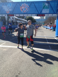 Liz and Mike celebrate at the finish line of the Chevron Houston Marathon/Aramco Houston Half-Marathon on Sunday, Jan. 19.