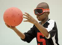 Terrence Reid-Sumter, 13, readies the 3.5 pound goalball for a serve.  Blind and visually impaired athletes play goalball at the Bradfield Recreation Center in Garland recently.