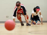 Libby Daugherty, 15, of Mesquite, scrambles to her right side sensing that the goalball has been serviced to that side of her court.  Blind and visually impaired athletes play goalball at the Bradfield Recreation Center in Garland recently.