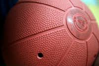 The goalball is similar in size to a basketball but is heavy rubber weighing in at 3.5 pounds and it has bells inside that can be heard through small holes on the outside of the ball.