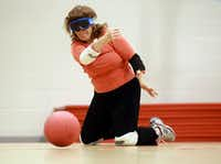 DMN writer Nancy Churnin tries her hand at goalball.  Churnin used goggles to block out all sight while playing the game. Blind and visually impaired athletes play goalball at the Bradfield Recreation Center in Garland recently.