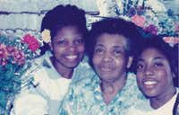 Myiesha Taylor with her mother and grandmother in a low-resolution photo. From left to right it is Carolyn Bartlett, Margaret Montgomery, Myiesha Taylor.