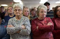 Globe Manufacturing Co. employees Shirley Smith (left) and Pat Dexter took in what Jon Huntsman had to say as he campaigned at their plant in Pittsfield, N.H., on Wednesday.