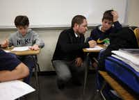 Substitute teacher John Zancana, with Joseph Lane, 14, (right), is 26-year-old University of Texas at Dallas graduate who abandoned an office chair for a chalkboard and hopes of impacting a younger generation. He has yet to find a full-time teaching job.