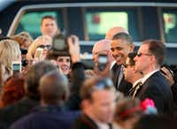 President Barack Obama greets with selected guest in a en after arriving at Love Field  in Dallas, Texas aboard Air Force One on Wednesday, November 6, 2013.  (Brad Loper/The Dallas Morning News)Brad Loper - Staff Photographer