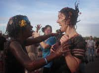 Shanita Mims embraces her friend Ladessa Jones during a tomato battle at theTexas State Fairgrounds November 12, 2011 in Dallas. Past tomato fights have been hosted in Colorado, California and Washington.