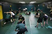 Packed into a double-wide trailer converted into a wrestling room, the Birdville High wrestling team runs drills during practice at Birdville High School in North Richland Hills, TX. on Friday Oct. 12, 2012. The teams recent explosion in size has forced the team and head coach James Gillespsie to creatively use their limited resources.