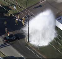 The fleeing car hit a fire hydrant and rolled before crashing into the house's garage, authorities said.