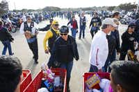 Partipants in the MotorCops for Kids Toy Run drop off their toy donations in front of the Hella Shrine temple in Garland at the end of the ride.