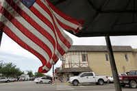 A flag waved this week on Main Street, where the town's small-town values remain intact.