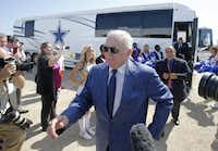 """Cowboys owner Jerry Jones, followed by Mayor Maher Maso and schools Superintendent Jeremy Lyon, walks from a team bus to the site of Friday's groundbreaking for a multi-use event center and the Cowboys' new headquarters. Maso said the project is coming together step by step: """"Every day I look at something new out here, and I say, 'Wow!' """"Vernon Bryant - Staff Photographer"""