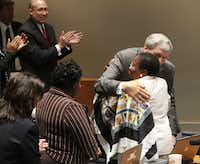 Dallas Mayor Tom Leppert and council member Vonciel Jones Hill embraced moments after Leppert announced his resignation at the end of the regular weekly Dallas City Council meeting on Wednesday.