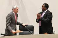 Dallas Mayor Pro Tem Dwaine Caraway stood and applauded Mayor Tom Leppert after Leppert announced his resignation.