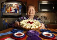 "Pie master Dorothy Lacefield is photographed in her Frisco kitchen with her special key lime pie. For years, Dorothy has dominated pie competitions at the State Fair of Texas. In 2009, when Oprah Winfrey (left, on refrigerator) taped her show at the State Fair, she loved Dorothy's Spectacular Lemon Mousse Pie so much that Dorothy won the Oprah ""Best of the Best"" competition."