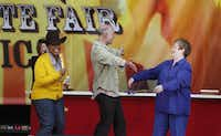 "During the taping of her TV show at the State Fair of Texas on Oct. 12, 2009, Oprah Winfrey (left) announces the Spectacular Lemon Mousse Pie made by pie master Dorothy Lacefield (far right) as winner of the Oprah ""Best of the Best"" competition among the top State Fair baking winners."