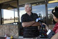Walt Hedrick, owner of Forum Roller World, speaks with reporters the morning after a massive shooting took place at his skating rink.