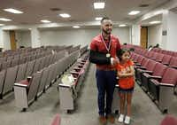 DIVERT graduate Stephan Chavez was joined by his sister, Gabriella Uresti, 7, after the July graduation ceremony at the Frank Crowley Courts Building.