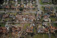 An aerial image taken Sunday, December 27, 2015 shows the path of a tornado through Garland, Texas. Violent storms ripped through the North Texas area late Saturday, spawning tornados that killed 11 people. (G.J. McCarthy/The Dallas Morning News)