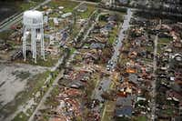 An aerial image taken Sunday, December 27, 2015 shows the path of a tornado in Rowlett, Texas. Violent storms ripped through the North Texas area late Saturday, spawning tornadoes that killed 11 people. (G.J. McCarthy/The Dallas Morning News)