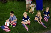 (From left) Ray Hoffman, and siblings Luke Silvers, Marylee Silvers and Jack Silvers, along with their dog, Dylan, watch a parade go by during the Little Forest Hills 4th of July Celebration Friday, July 4, 2014 in Dallas. In its 12th year, the event drew scores of people from the east Dallas neighborhood and featured a parade, music and food. (G.J. McCarthy/The Dallas Morning News)G.J. McCarthy - Staff Photographer