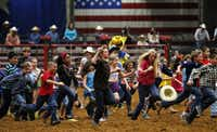 It was a wild run for kids as a pair of calves were turned loose during the Dash for Cash on Saturday at Mesquite ProRodeo. The rodeo runs every Friday and Saturday through Aug. 24.