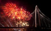 "Fireworks exploded over the Margaret Hunt Hill Bridge following opening-night festivities in March. Retired banker Bob Thornton III was smitten by the bridge during its opening. ""Even though it was so structurally strong, there was a delicacy to it."""