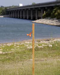 A marker beside Lewisville Lake hints at the I-35E expansion to come, which will include construction of another bridge.