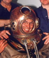 Steve Blow donned an antique diving suit -- and tested it out in a pool under supervision of a Garland professional diver -- for an April 2000 column.
